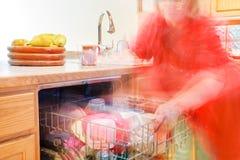 Ocupado en la cocina Foto de archivo libre de regalías