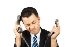 Ocupado y cansado en el teléfono Foto de archivo libre de regalías