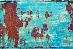Odłupanej farby metalu ośniedziały textured tło Fotografia Stock