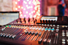 Od adjusters and red buttons of a mixing console. It is used for audio signals modifications to achieve the desired Stock Image