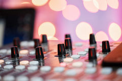 Od adjusters and red buttons of a mixing console. It is used for audio signals modifications to achieve the desired Stock Photo