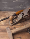 Od vintage hand tools on wooden background stock image