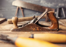 Od vintage hand tools on wooden background. Royalty Free Stock Image