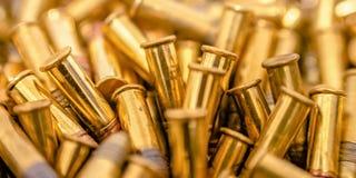 Odbijający złoci pociski gromadzący się wpólnie zdjęcie royalty free