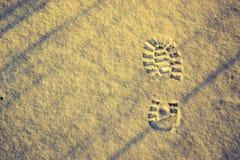 Odcisk stopy przy śniegiem Fotografia Stock