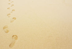 Odcisk stopy w piaska tle Obrazy Royalty Free