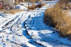 Odciski stopy od samochodu w śniegu Fotografia Stock