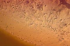Odciski stopy w piasku od above Obrazy Stock