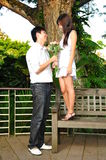 Odd Asian Couple looking at each other Royalty Free Stock Photos