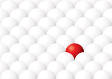 Odd ball out. Illustration of being different with one red ball againt many white Stock Photography