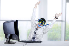 Odd businessman expressing success. Portrait of businessman wearing a snorkeling mask and expressing success in the office Stock Images
