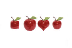 Odd fruits with clipping path. Four red apples of various shapes on a white background with rain drops and love hearts with clipping path royalty free stock photography