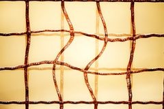 Odd grid of a fence. With rust Royalty Free Stock Photography