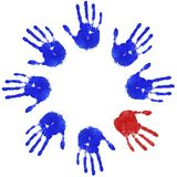 Odd hand circle. Images of blue handprints with an odd red one, concepts of Teamwork, Equality and Diversity Stock Photo