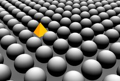 Odd one out. Many grey balls with one orange triangle Royalty Free Stock Photography