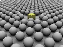 Odd one Out. A group of spheres edging away from a yellow cube Stock Illustration