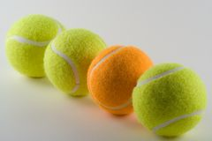 Odd One Out. Odd tennis ball Stock Photography