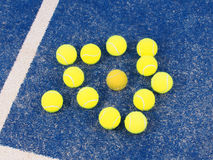 Odd one out dirty Tennis ball amongst pristine balls Royalty Free Stock Photo