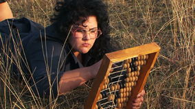 Odd Plus-Sized Woman In Black Playing With Abacus stock footage