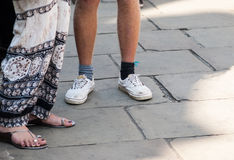 Odd shoes and socks. Together on the streets of Cambridge Stock Photo