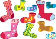 Odd socks. A cartoon of several different colored odd socks Stock Photography