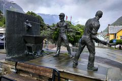The monument to smelters in Odda, Norway. Odda, Norway - June 19, 2018: The monument `Smeltaren` by Oddmund Raudberget, dedicated to workers of local zinc royalty free stock image