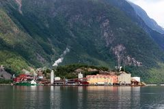 The Odda zinc smelter plant in Norway. Odda, Norway - June 20, 2018: The Odda zinc smelter of Boliden, established back in the 1920s, produces zinc and sulphuric stock images