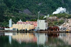 The Odda zinc smelter plant in Norway. Odda, Norway - June 20, 2018: The Odda zinc smelter plant of Boliden, established back in the 1920s, produces zinc and stock photography