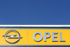 Opel logo on a wall. Odder, Denmark - September 30, 2015: Opel logo on a wall. Opel is a german automobile manufacturer headquartered in Russelsheim, Germany and Stock Photo