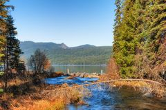 Odell Lake in the Oregon Cascades Range. A stream empties into Odell Lake in Oregon`s Cascade Range royalty free stock photos