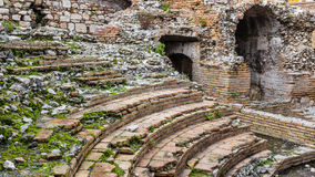 Odeon - Ancient greek theater of taormina, the ruins. A detail of the ruins of Odeon, the ancient greek theater of taormina, in sicily, landscape cut Royalty Free Stock Photos
