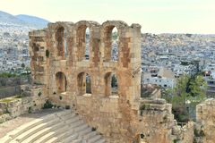 Odeon of Herodes Atticus with Athens in the background. Columns of the Odeon of Herodes Atticus in ruins with Athens in the background stock image