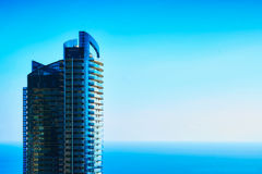 Odeon Tower - the tallest skyscraper in Monaco. Aerial view of a skyscraper and the blue sea below Royalty Free Stock Photos