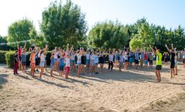 Children and teenagers on morning exercises at summer camp. Odesa rgn. Ukraine, August 4, 2018: Children and teenagers on morning exercises at summer camp stock image