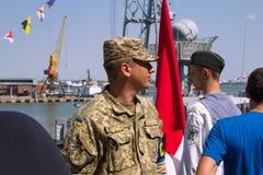 Odesa, Ukraine - July 03, 2016: Ukrainian Military officer in the Port, guarding during celebration NAVY forces day. Odesa, Ukraine - July 03, 2016: Ukrainian royalty free stock photo