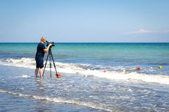 Odesa, Ukraine - June 4, 2016: TV camera man filming a beach spo. Rt event, windsurfing competition stock image
