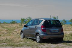Odessa 05.31.2018. Car Mercedes B-class on the beach. stock photography