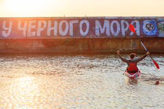 Odessa 2017. Kayaking on the Black Sea. A man is holding an oar in his hand, sitting on a kayak. Stock Photo