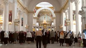Odessa, Ukraine - April 23, 2014: Orthodox Christian believers. After the Religious Procession, to the Savior Transfiguration Cathedral, praying for the