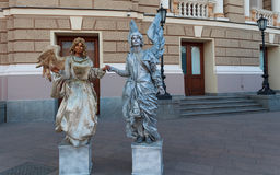 Odessa, Ukraine - August 24, 2015:  Couple depicting living statue Royalty Free Stock Photos