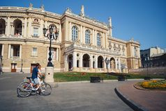 ODESSA, UKRAINE - AUGUST 06, 2015: cute young beautiful hipster couple with bikes travelling Europe.  royalty free stock photos