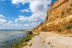 Odessa, Ukraine - August 31, 2013: Family resting on a wild beach. stock images