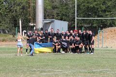 Odessa, Ukraine - August 29, 2020: Odessa National Team CREDO red - Kiev Antares black rugby 7s. Sharp aggressive fight of