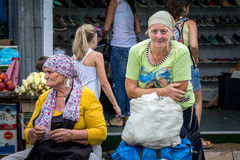 ODESSA, UKRAINE - AUGUST 13, 2015: Old woman selling vegetables on Privoz market, the main market of Odessa, Ukraine Royalty Free Stock Images