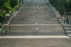 ODESSA, UKRAINE - AUGUST 6, 2014: Potemkin stairs with people posing on them. Royalty Free Stock Photo