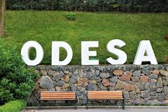 Odessa, Ukraine. Benches in the `` Istanbul Park `` with the written ``Odesa `` stock photography