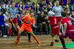 Odessa, Ukraine -Decemb 25, 2018: Young children play rugby while playing in city school derby in closed room. Children`s sport. Children play rugby 5. Fight stock photo