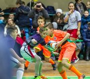 Odessa, Ukraine -Decemb 25, 2018: Young children play rugby while playing in city school derby in closed room. Children`s sport. Children play rugby 5. Fight royalty free stock images