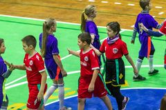 Odessa, Ukraine -Decemb 25, 2018: Young children play rugby while playing in city school derby in closed room. Children`s sport. Children play rugby 5. Fight royalty free stock image