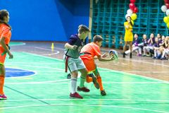 Odessa, Ukraine -Decemb 25, 2018: Young children play rugby while playing in city school derby in closed room. Children`s sport. Children play rugby 5. Fight royalty free stock photography